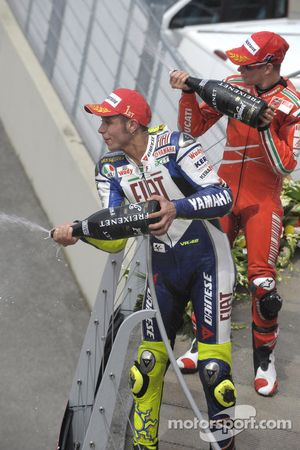 Podium: race winner Valentino Rossi and second place Casey Stoner