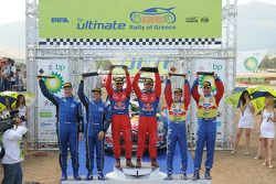 Podium: winners Sébastien Loeb and Daniel Elena, second place Petter Solberg and Phil Mills, third place Mikko Hirvonen and Jarmo Lehtinen