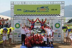 Podium: winners Sébastien Loeb and Daniel Elena, second place Petter Solberg and Phil Mills, third p