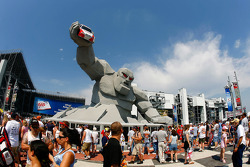 Fans flock to the new Monster Monument at Victory Plaza as they enter Dover International Speedway on race day