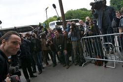 Members of the media wait for hours in front of the FIA Place de la Concorde headquarters