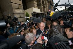 FIA deleguates exits the FIA Place de la Concorde headquarters after the Extraordinary General Assem