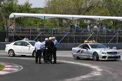 Charlie Whiting, FIA Safty delegate, Race director & offical starter and Herbie Blash, FIA, observin