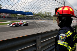 A woman from the Fire Department watching qualifying