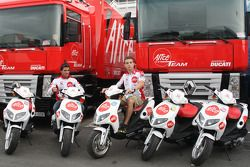 Toni Elias and Sylvain Guintoli pose with scooters