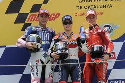 Podio: ganador de la carrera Dani Pedrosa, segundo lugar Valentino Rossi y tercer lugar Casey Stoner