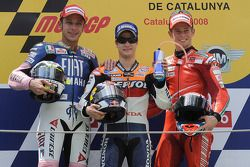 Podium: race winner Dani Pedrosa with Valentino Rossi and Casey Stoner