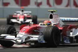 Timo Glock, Toyota F1 Team, TF108 leads Jarno Trulli, Toyota Racing, TF108