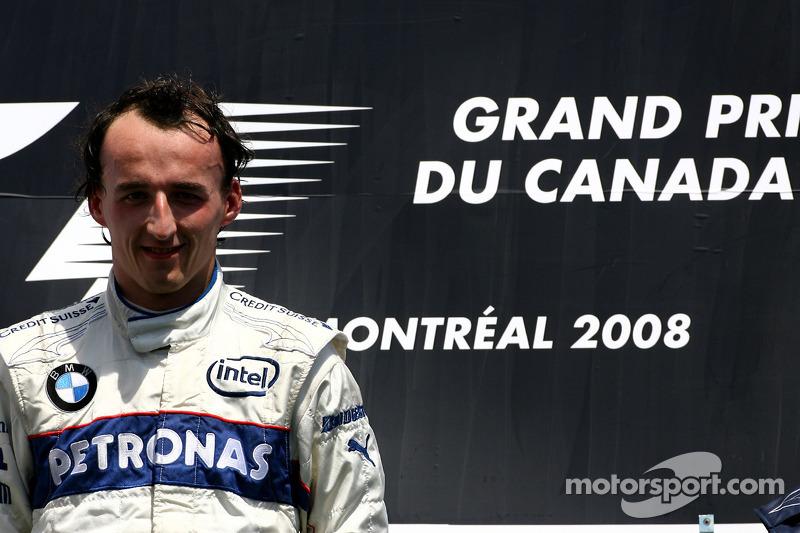 Podio: ganador de la carrera Robert Kubica
