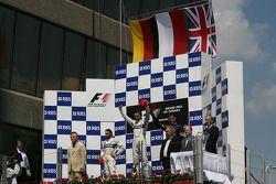 Podium: race winner Robert Kubica with Nick Heidfeld and David Coulthard