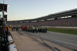 Cars are gridded on the pit lane