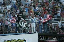Robbie Knievel address the crowd after his jump