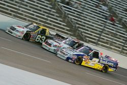 P.J. Jones, Mike Skinner and Ron Hornaday go three wide in the corner 4