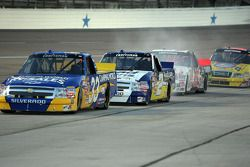 Ron Hornaday leads the pack into the pit lane