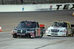 Dennis Setzer and P.J. Jones enter the pit lane