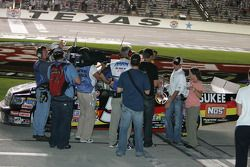 Reporters gather around Kyle Busch after the race
