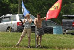 Porsche fans waving a flag