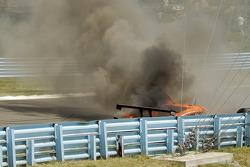 The burning #47 Doran Racing Ford Dallara: Richard Antinucci, Burt Frisselle, Gabriele Gardel