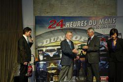 Martin Birrane accepts the award from Jean-Claude Plassart