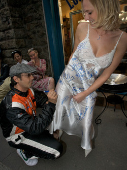 Michael Vergers signs his name on a night gown