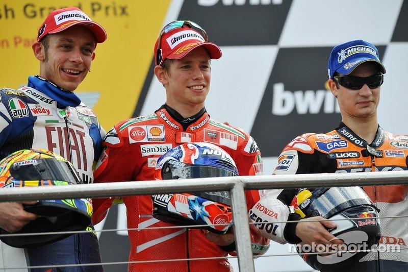 Podio: ganador de la carrera Casey Stoner, Valentino Rossi el segundo lugar y tercer lugar Dani Pedr