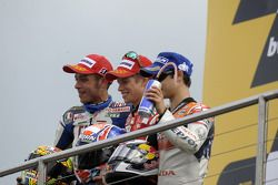 Podium: race winner Casey Stoner, second place Valentino Rossi, third place Dani Pedrosa