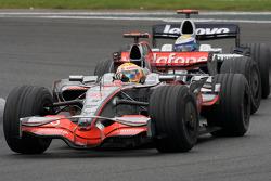 Lewis Hamilton, McLaren Mercedes, passes Nico Rosberg, WilliamsF1 Team