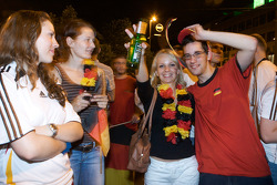 Happy fans celebrate Germany's Euro Cup 2008 semi-final win in the streets of Nurnberg