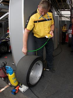 Dunlop technician checks tire temperature