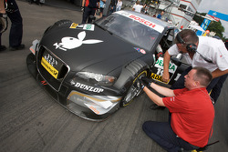 Audi Sport Team Rosberg team members check damage on the car of Markus Winkelhock after a contact on