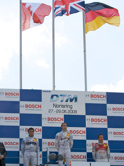 Podium: race winner Jamie Green, second place Bruno Spengler, third place Timo Scheider