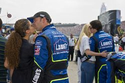 Chad Knaus and Jimmie Johnson kiss their significant others before the race