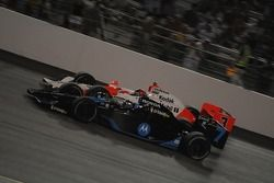 Danica Patrick and Helio Castroneves running together