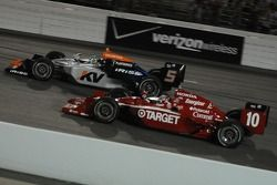 Oriol Servia and Dan Wheldon running together