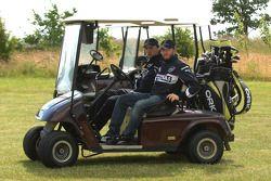 BMW Sauber F1 Team drivers Nick Heidfeld and Robert Kubica play golf at the Whittlebury Park Golf Cl