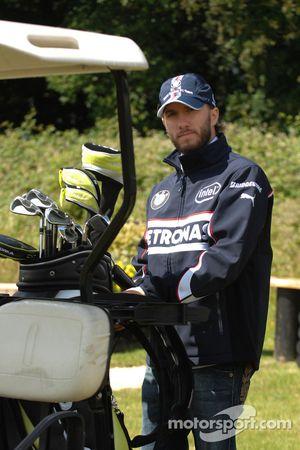 BMW Sauber F1 Team drivers Nick Heidfeld and Robert Kubica play golf at the Whittlebury Park Golf Club near Silversone circuit