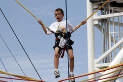 A young boy tries out one of the attractions in the Fan Zone