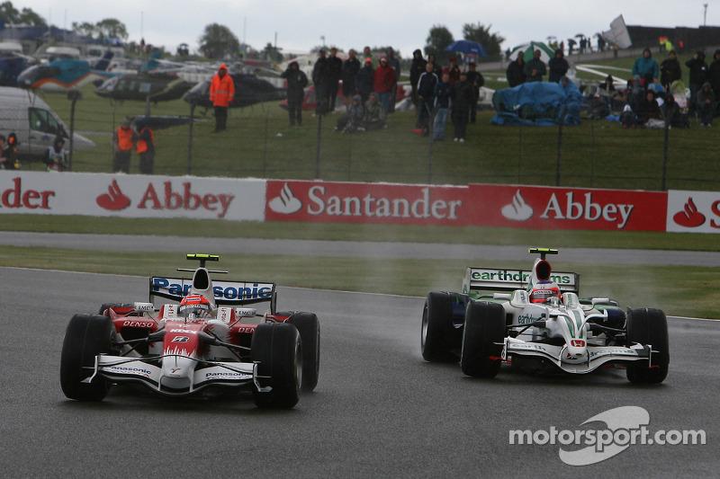 Timo Glock, Toyota F1 Team, TF108 y Rubens Barrichello, Honda Racing F1 Team, RA108