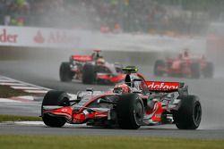 Heikki Kovalainen, McLaren Mercedes, MP4-23 leads Lewis Hamilton, McLaren Mercedes