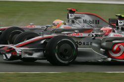 Lewis Hamilton, McLaren Mercedes overtakes Heikki Kovalainen, McLaren Mercedes
