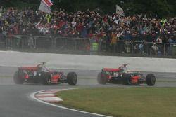 Lewis Hamilton, McLaren Mercedes, MP4-23 leads Heikki Kovalainen, McLaren Mercedes, MP4-23