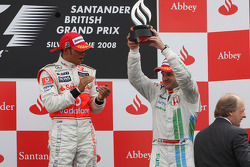 Podium: race winnaar Lewis Hamilton met 3e coureur Rubens Barrichello