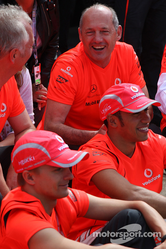 McLaren Mercedes victory celebration: race winner Lewis Hamilton celebrates with Heikki Kovalainen, Ron Dennis and McLaren team members