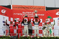GT500 podium: race winners Joao Paulo Lima De Oliveira and Seiji Ara, second place Michael Krumm and