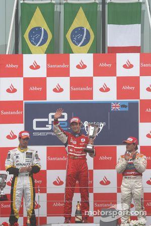 Bruno Senna celebrates victory on the podium with Lucas di Grassi and Giorgio Pantano