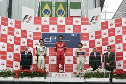 Bruno Senna celebrates his victory on the podium with Lucas di Grassi and Giorgio Pantano