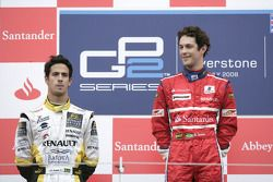 Bruno Senna celebrates his victory on the podium with Lucas di Grassi