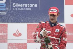 Bruno Senna celebrates his victory on the podium
