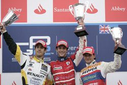 Bruno Senna celebrates his victory on the podium with Lucas di Grassi and Giorgio Pantano