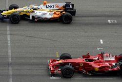 Start practice on the start-finish line: Kimi Raikkonen, Scuderia Ferrari and Fernando Alonso, Renault F1 Team